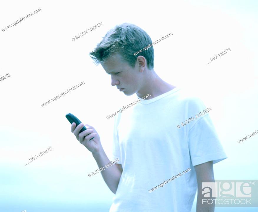 Stock Photo: Teen boy using cell phone.