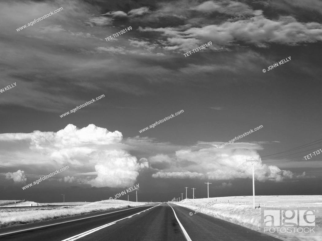 Stock Photo: Dark sky over deserted highway.
