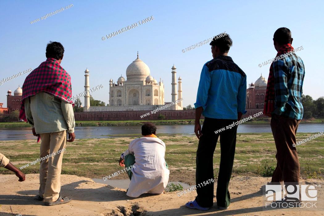Stock Photo: Local villagers viewing at Taj Mahal Seventh Wonders of World on south bank of Yamuna river , Agra , Uttar Pradesh , India UNESCO World Heritage Site.