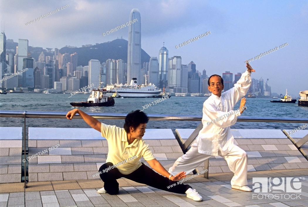 Stock Photo: people practising Tai Chi Chuan along the Victoria Harbour waterfront in Tsim Sha Tsui, Kowloon Peninsula, Hong-Kong, People's Republic of China, Asia.