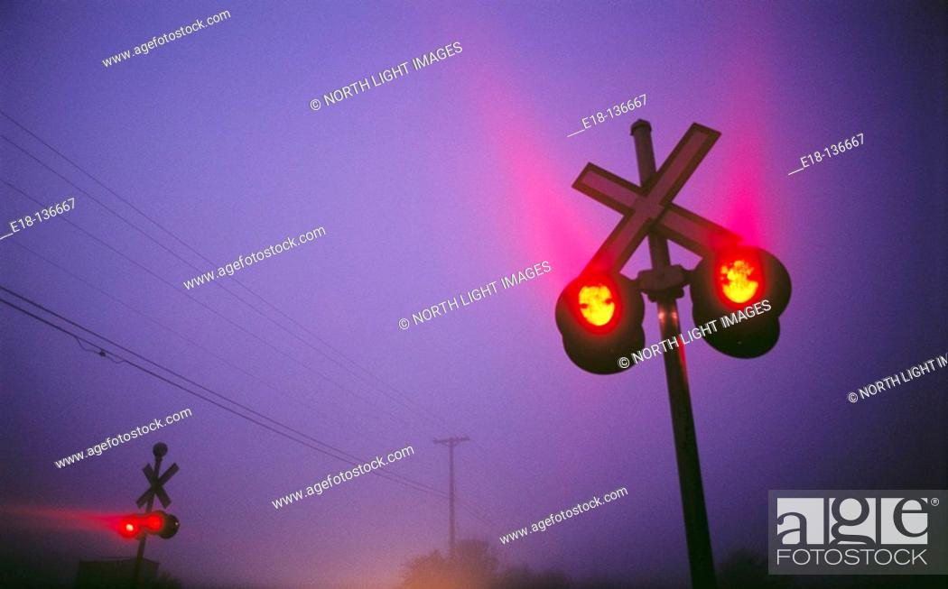 Stock Photo: Railway crossing signals on foggy morning in Ladner. Vancouver, British Columbia, Canada.