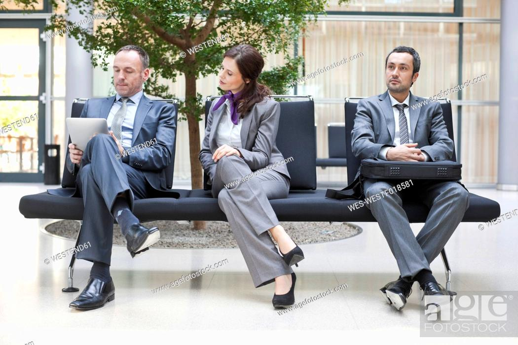 Stock Photo: Germany, Leipzig, Business people sitting on bench.