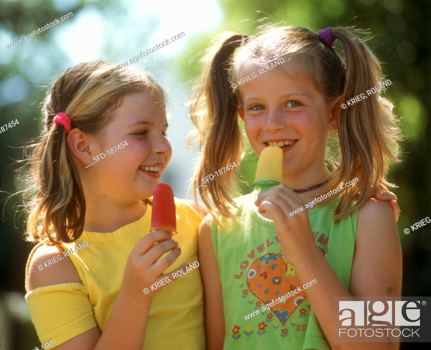 Two Girls Licking Ice Creams 2 Stock Photo Picture And Rights
