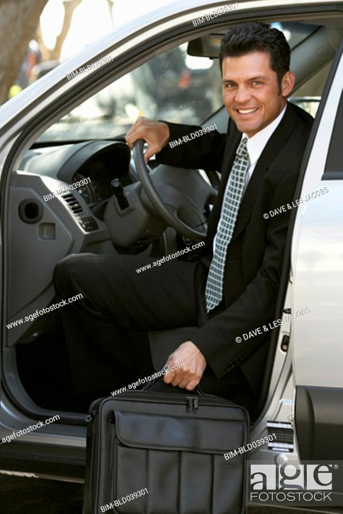 Stock Photo: Hispanic businessman getting out of car.