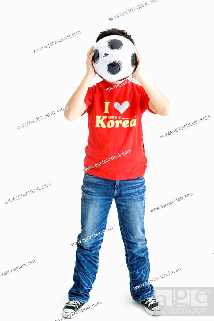 Stock Photo: boy holing soccer ball.