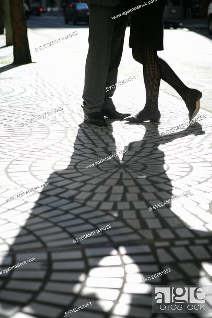 Stock Photo: Shadow of two people on the street.