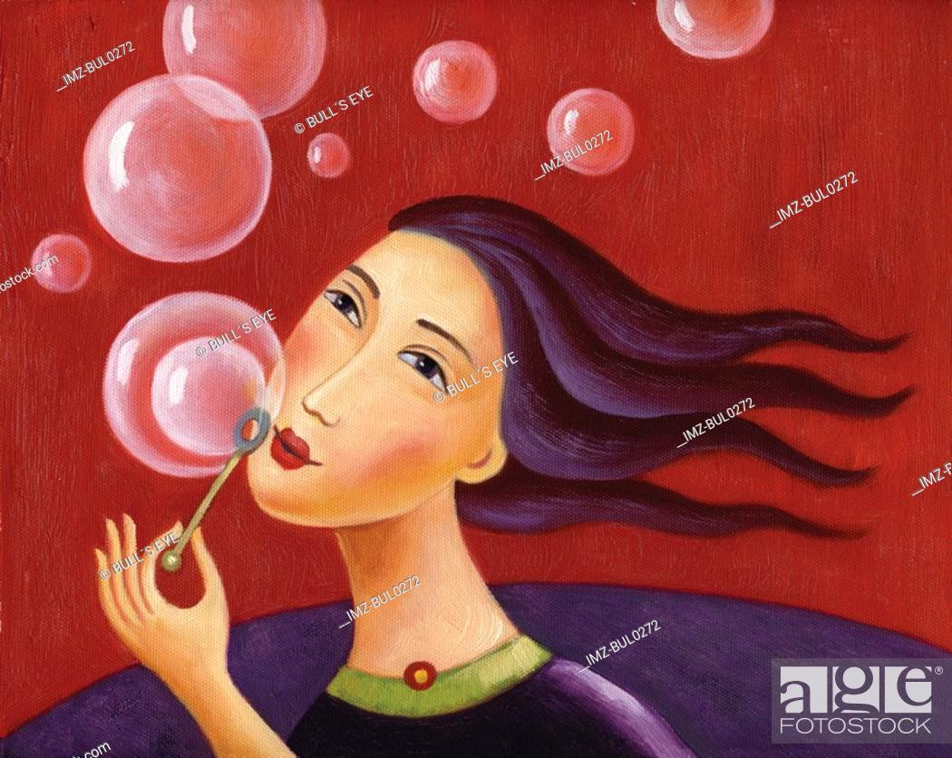 Stock Photo: Closeup of a woman blowing bubbles.