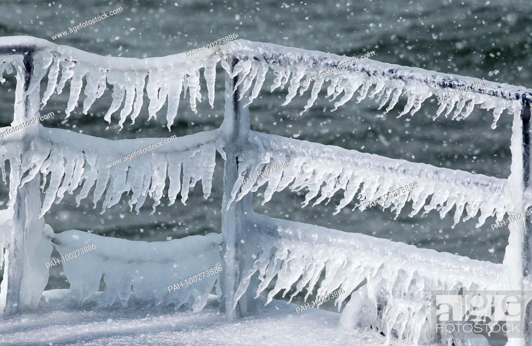 Stock Photo: Huge icicles formed by waves hanging on frozen ship's rail, Baltic Sea, Mecklenburg-Western Pomerania, Germany   usage worldwide.