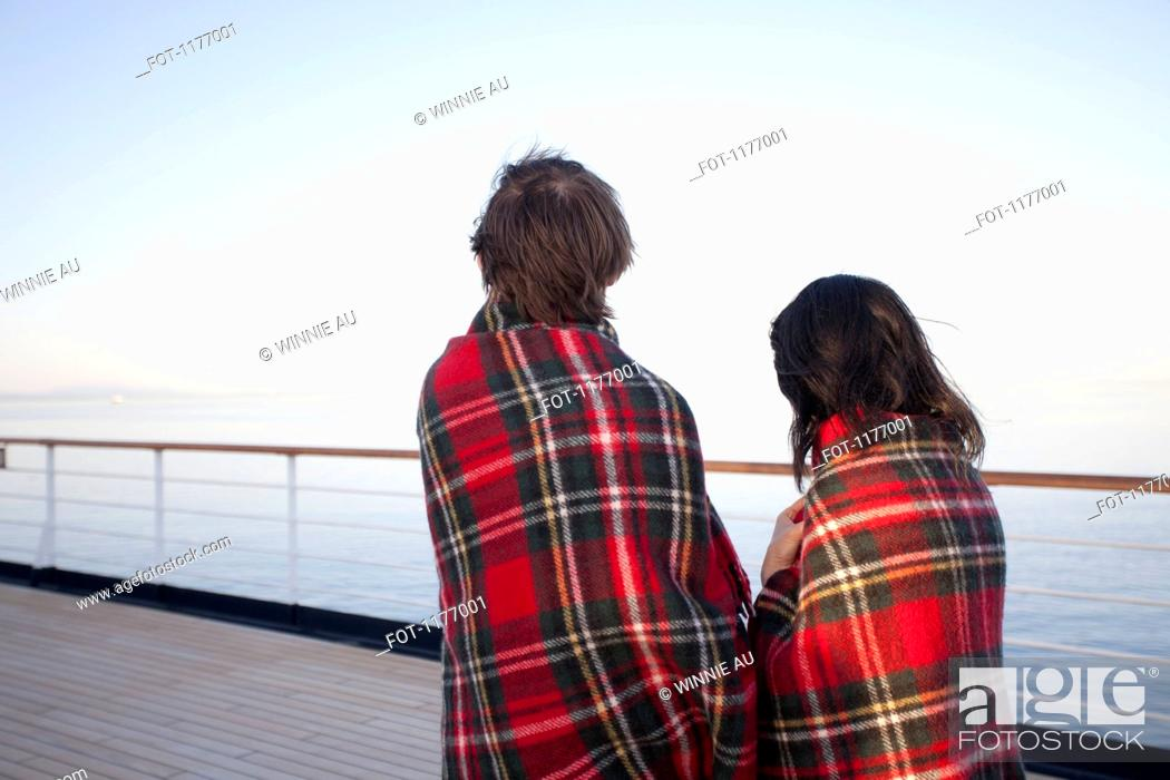 Stock Photo: A couple on a ship deck, wrapped in blankets, looking at view, Seattle, Washington, USA.