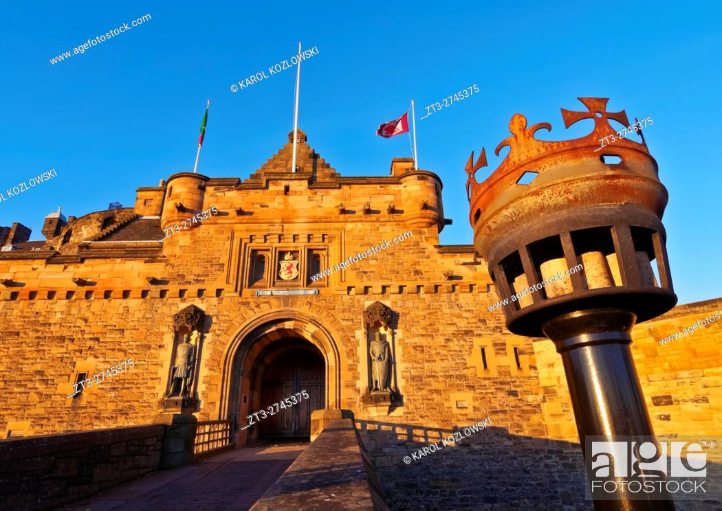 Stock Photo: UK, Scotland, Lothian, Edinburgh, View of the Edinburgh Castle illuminated by the sunrise. .