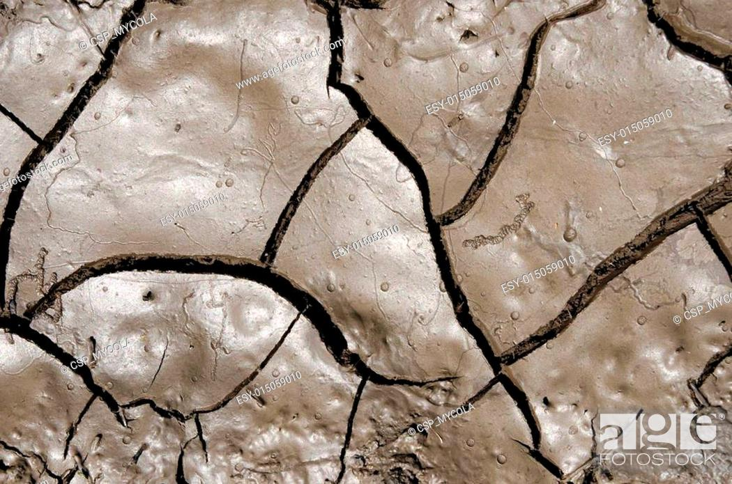 Stock Photo: wet earth with cracks.
