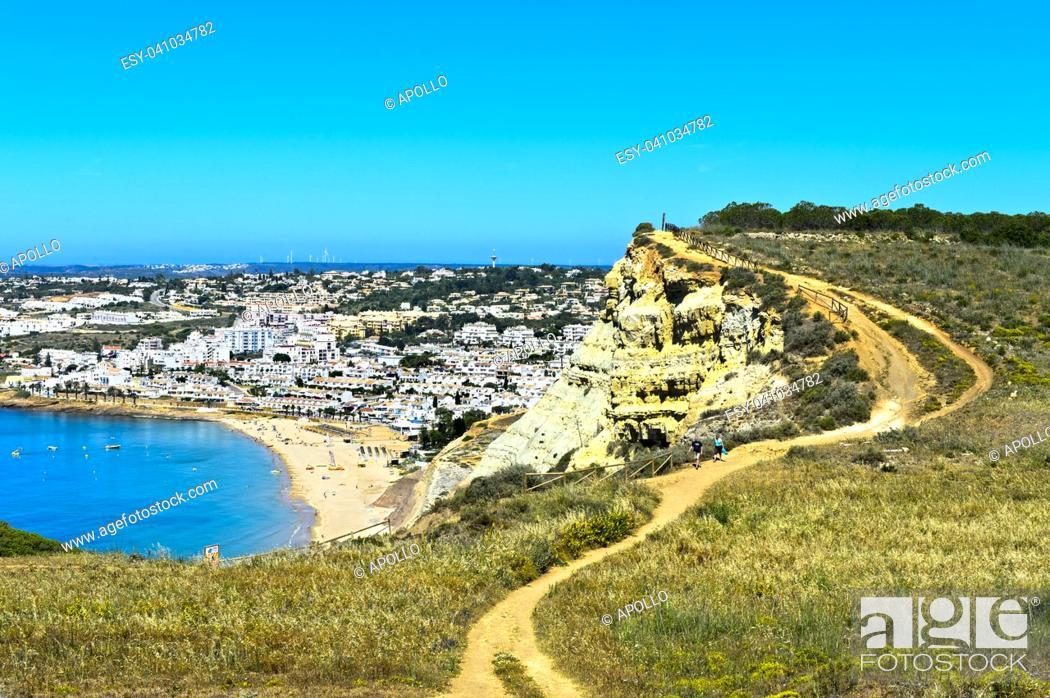 Stock Photo: Hiking trail along the rocky cliff near Luz, Algarve, Portugal.