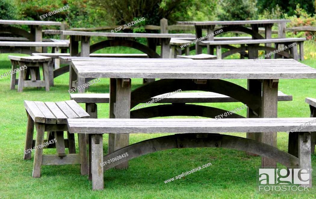 Stock Photo: Garden picnic tables.