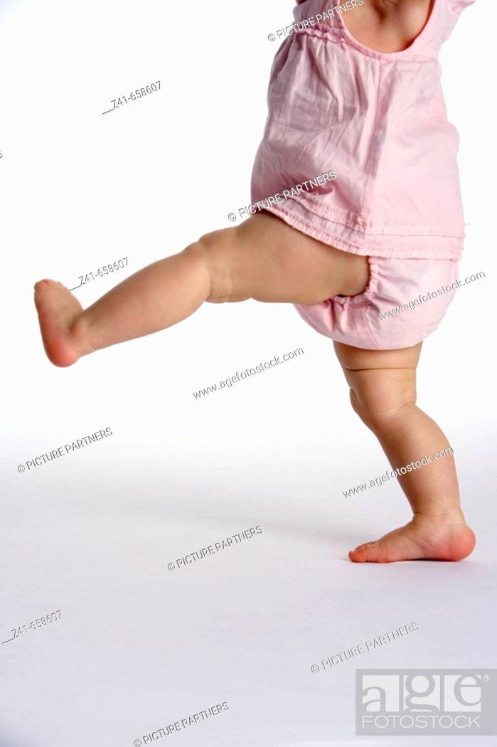 Stock Photo: Walking legs of a child.