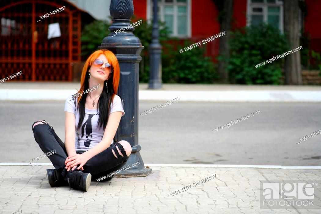 Stock Photo: redhead women outdoors in the street.