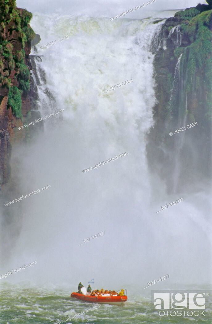 Stock Photo: Rubber dinghies getting closer to the falls. Iguazu National Park. Misiones province. Argentina.