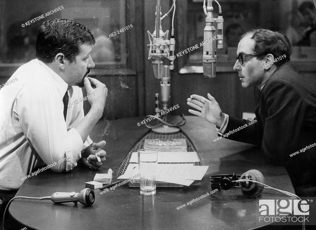 French film director Jean-Luc Godard being interviewed on