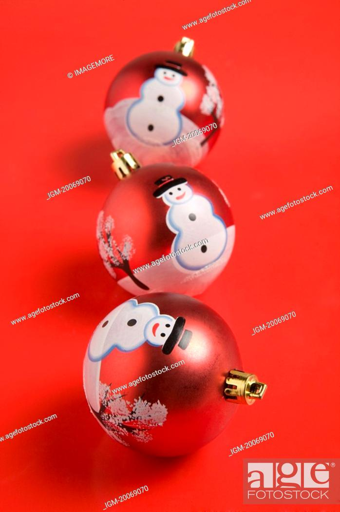 Stock Photo: Three Christmas baubles with patterns of snowman.