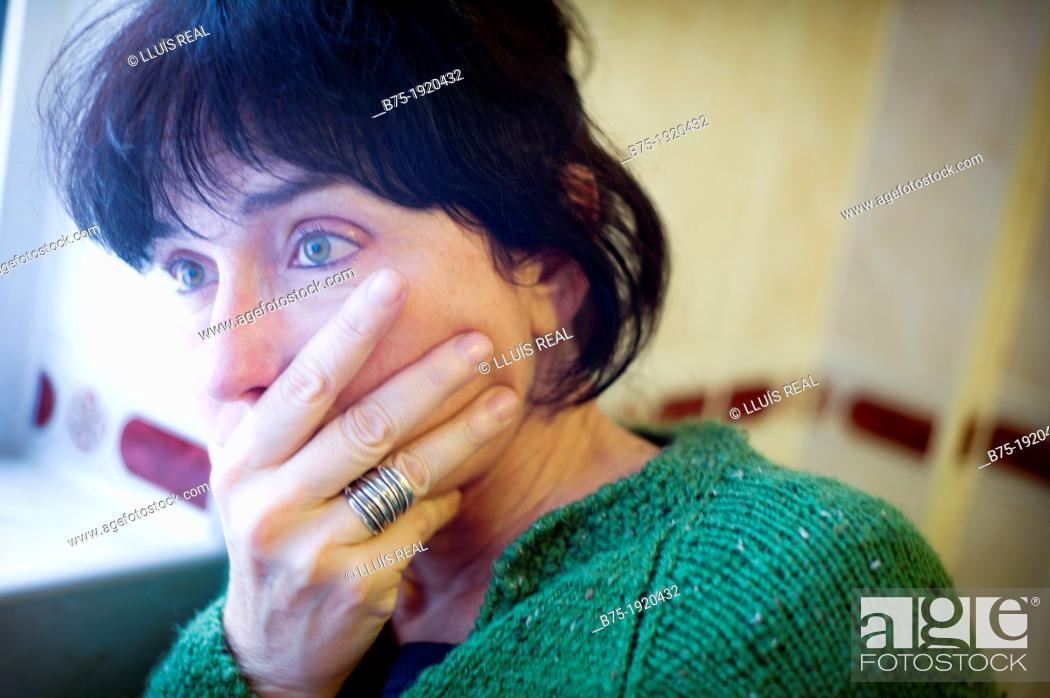 Stock Photo: Closeup of woman with expression of concern.