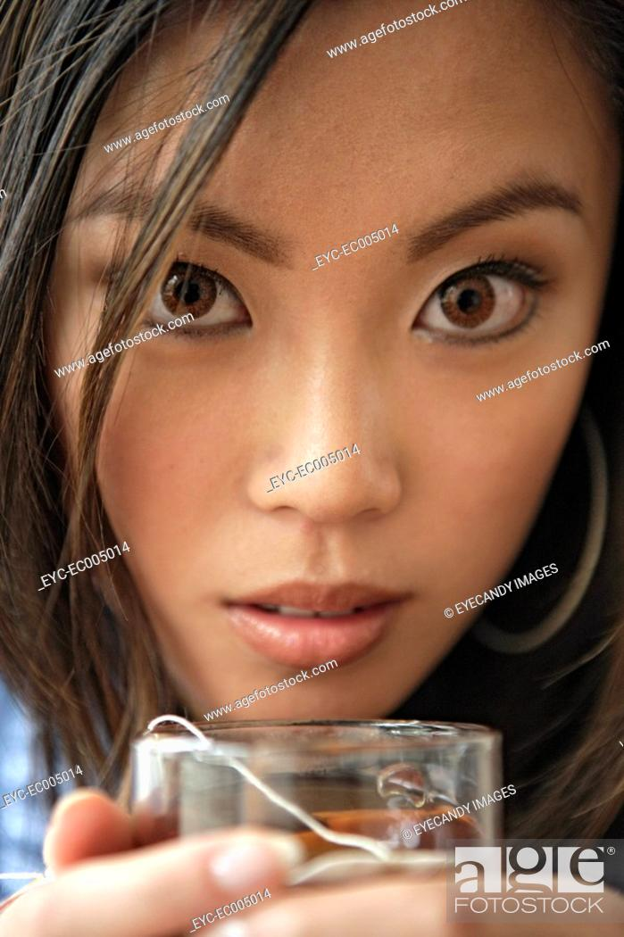 Stock Photo: One young woman holding glass, portrait.