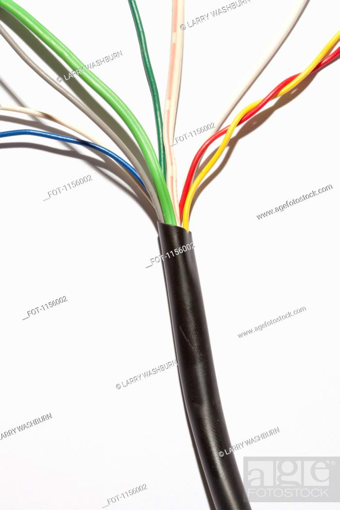 Stock Photo: A cable with different colored exposed wires spreading out from it.