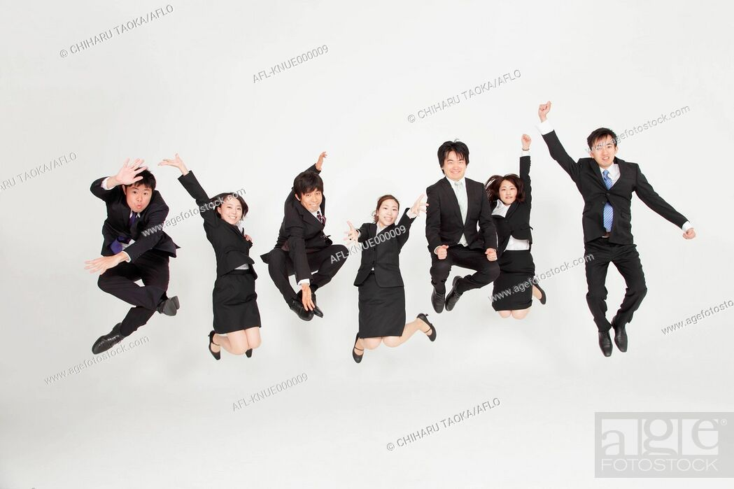 Stock Photo: Japanese business people jumping.
