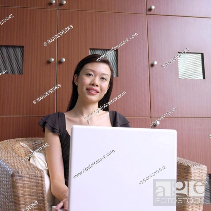 Stock Photo: Portrait of a businesswoman sitting in front of a laptop.