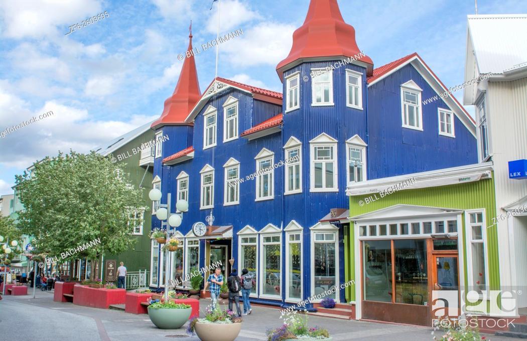 Stock Photo: Iceland Akureyri downtown center second largest city walking street Hafnarstraeti Street with blue cafe building.
