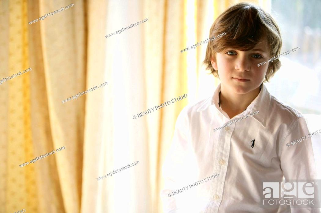 Stock Photo: Boy standing looking at camera.