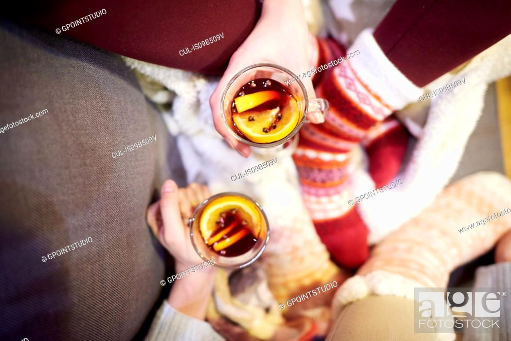 Stock Photo: Friends enjoying mulled wine.