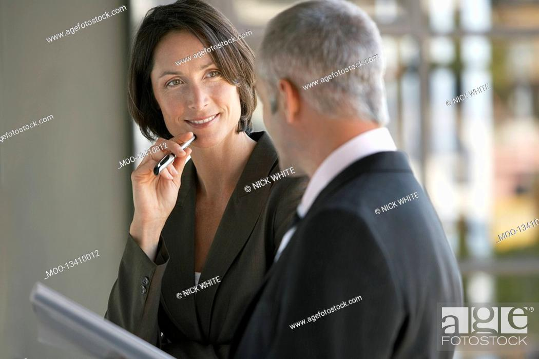 Stock Photo: Businessman and woman talking.