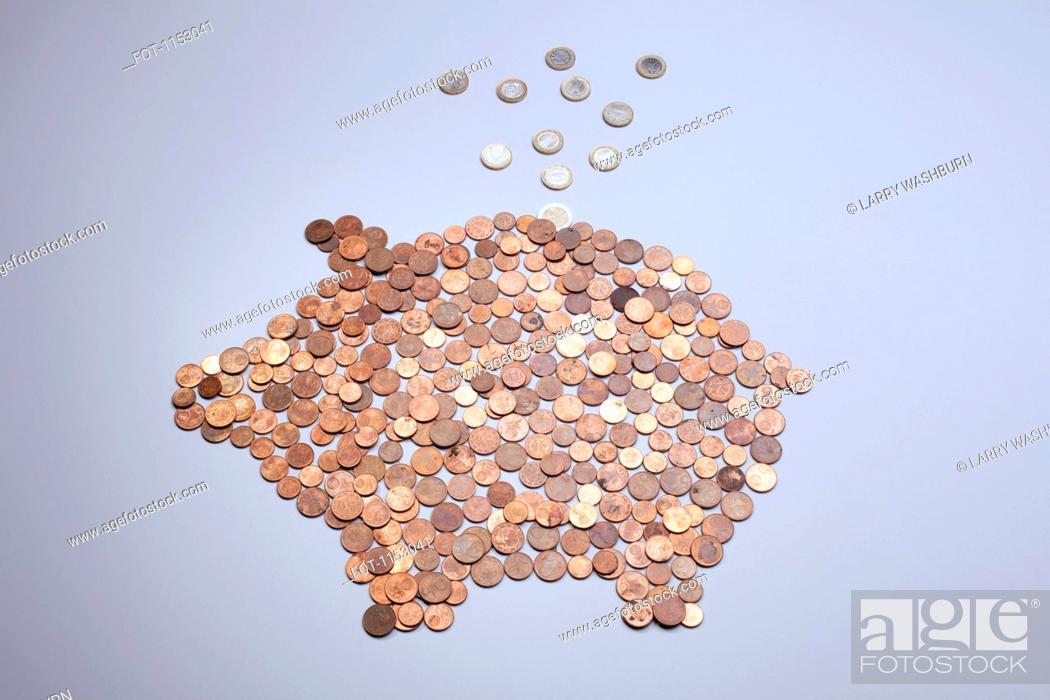 Stock Photo: Euro coins falling into a piggy bank made from arranged European coins.