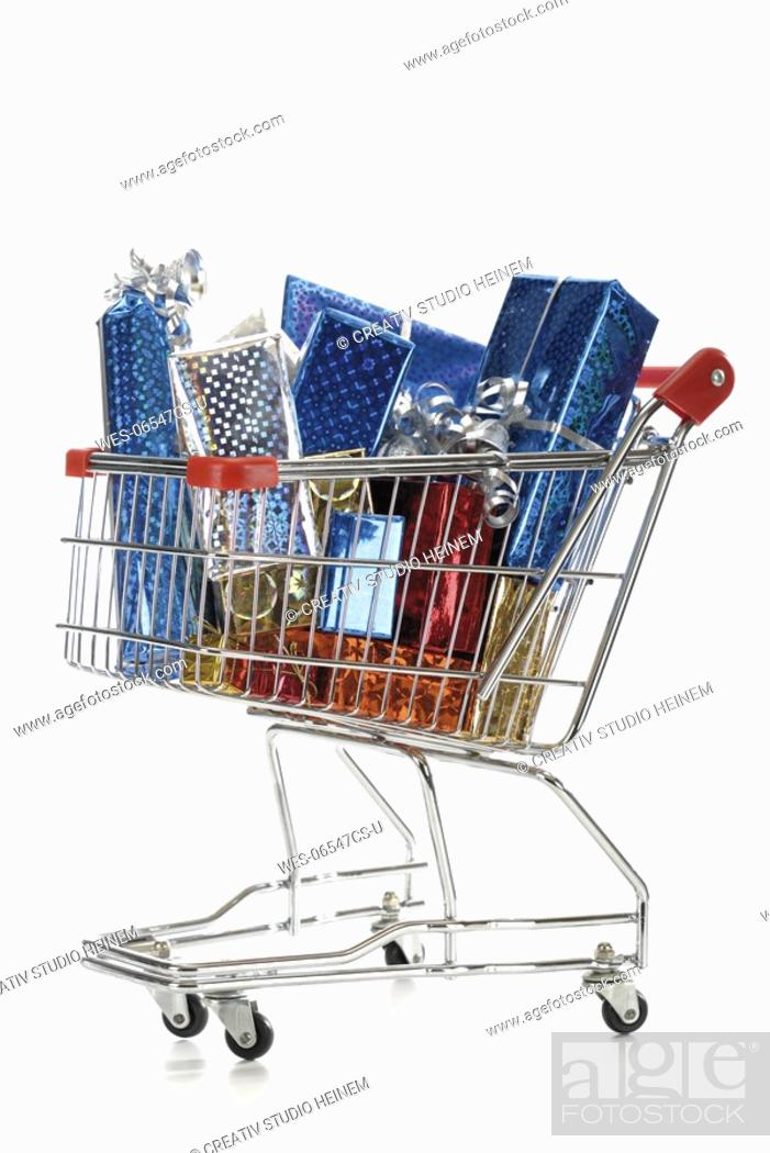 Stock Photo: Supermarket trolley with christmas parcels.