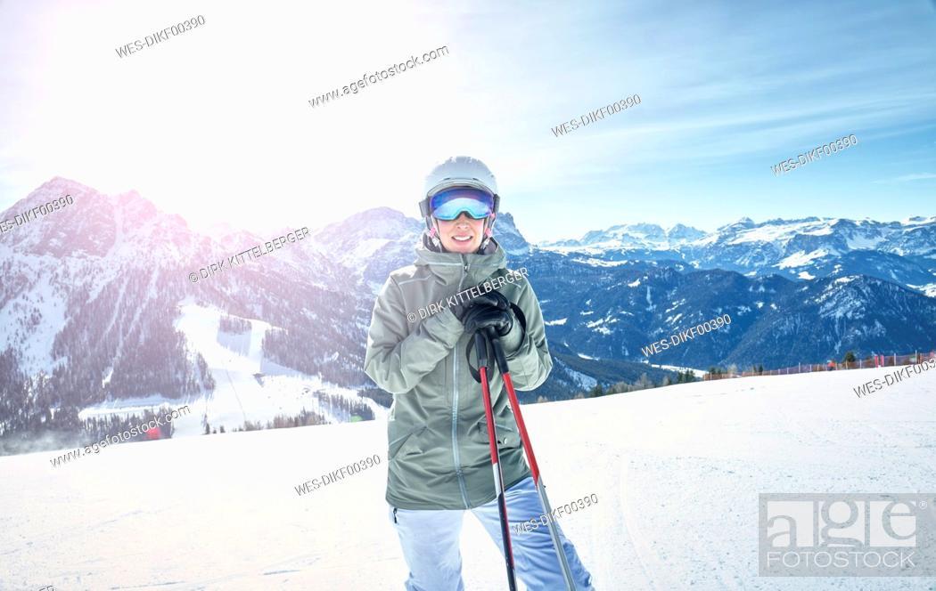 Stock Photo: Portrait of smiling female skier on ski slope.