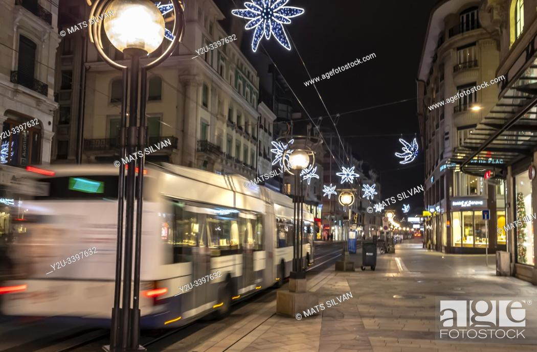Stock Photo: Main Shopping Street with a Bus at Night in geneva, Switzerland.