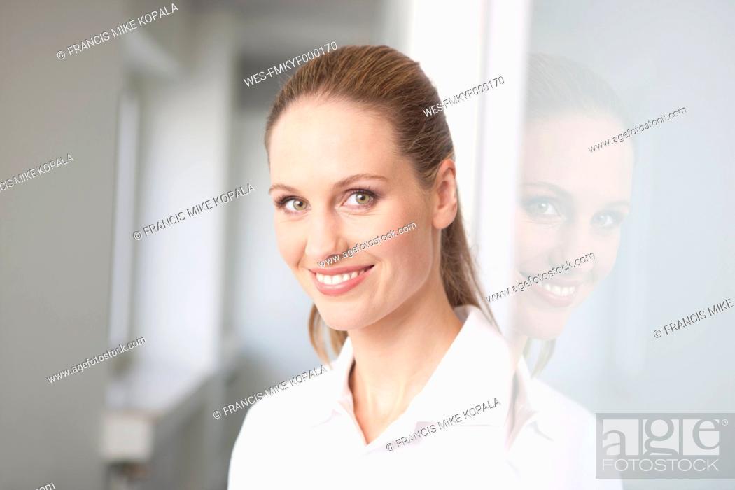 Stock Photo: Germany, Dentist smiling, portrait.