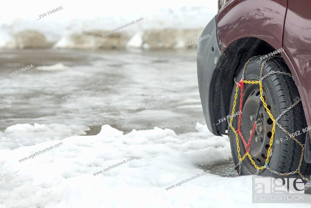 Stock Photo: Snow chains detail in Pyrenees snowed road.