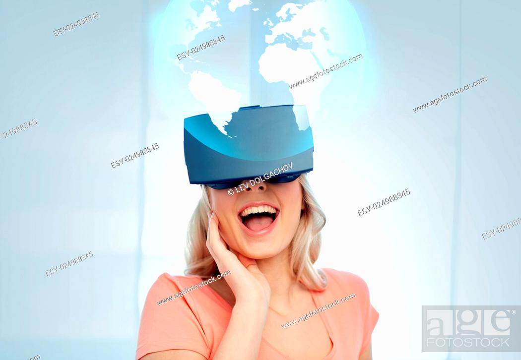 Stock Photo: technology, augmented reality, cyberspace, entertainment and people concept - happy amazed young woman with virtual headset or 3d glasses looking at projection.