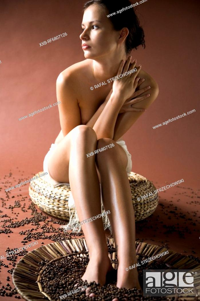 Stock Photo: Feet treatment with coffee grains.