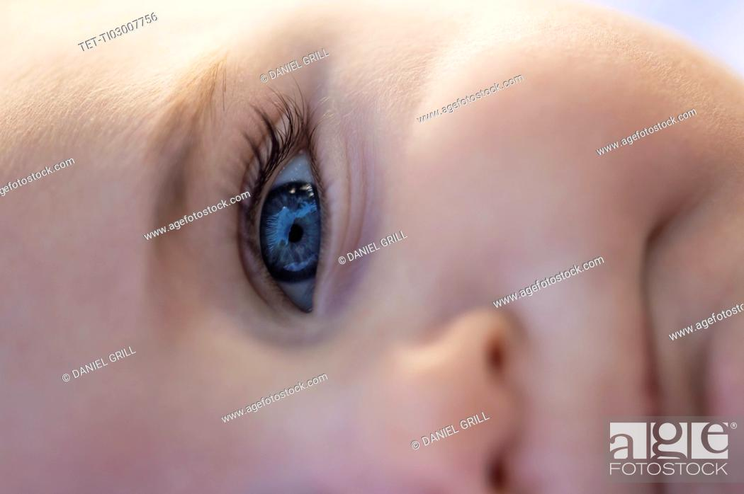 Stock Photo: Close-of baby boy's (6-11 months) blue eye.
