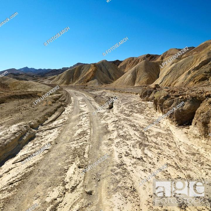 Stock Photo: Dirt road through Death Valley National Park.