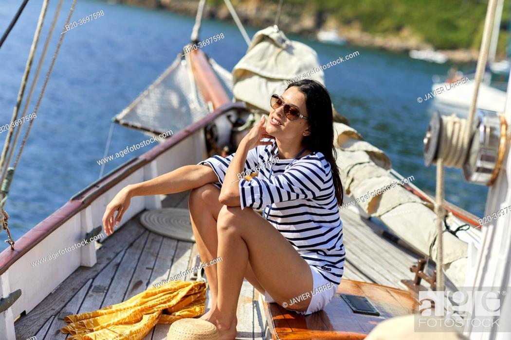 Stock Photo: Young woman with sailor clothes, Sailing boat, Pasaia port, Gipuzkoa, Basque Country, Spain, Europe.