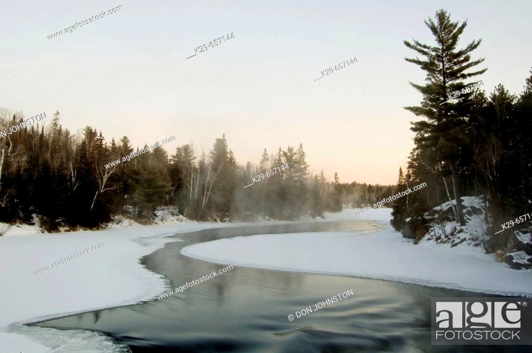 Stock Photo: Open water of Wahnapitei River above rapids before dawn on a cold winter morning. Ontario, Canada.