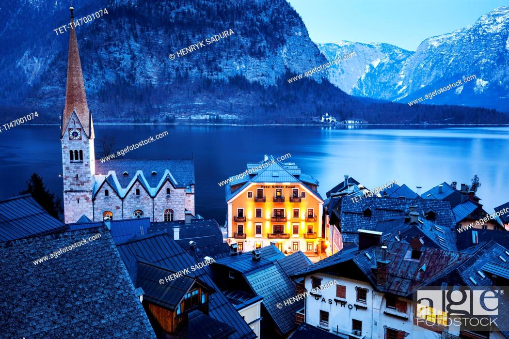 Stock Photo: Town with lake and mountains in background.