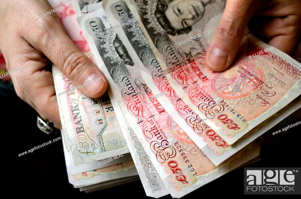 Stock Photo: pounds in the hands.