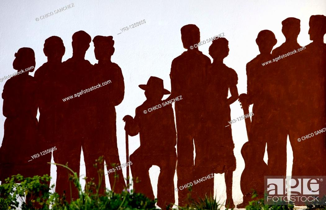 Stock Photo: A mural of silhouettes representing victims of the Spanish Civil War covers a wall in Benamahoma village, Cadiz province, Andalusia, Spain.