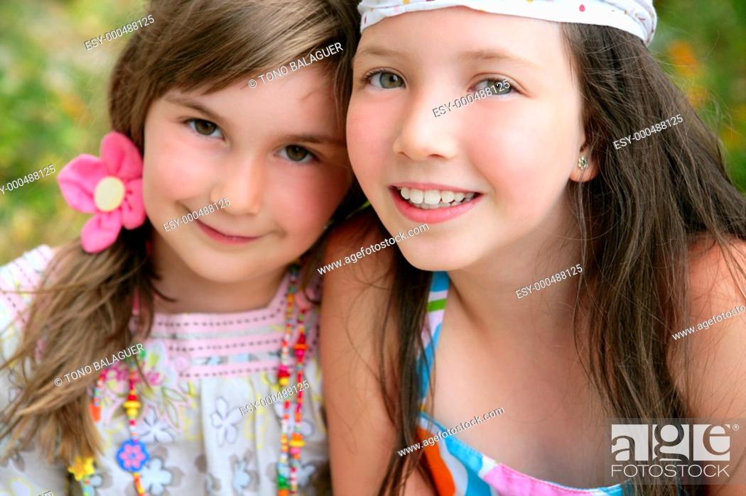 Stock Photo: closeup portrait of two little happy beautiful girl sisters.