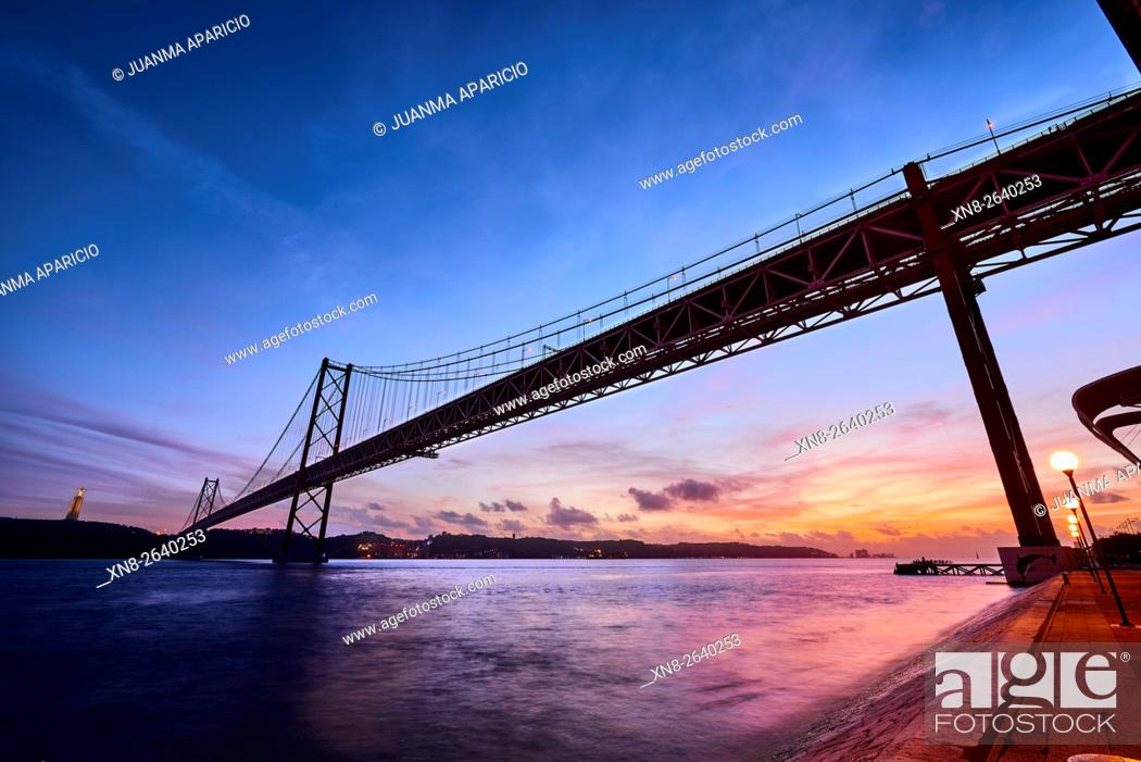 Stock Photo: The 25 April Bridge over the River Tagus in Lisbon, Portugal.