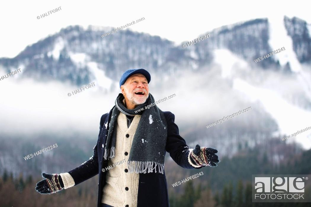 Stock Photo: Portrait of happy senior man in winter landscape.