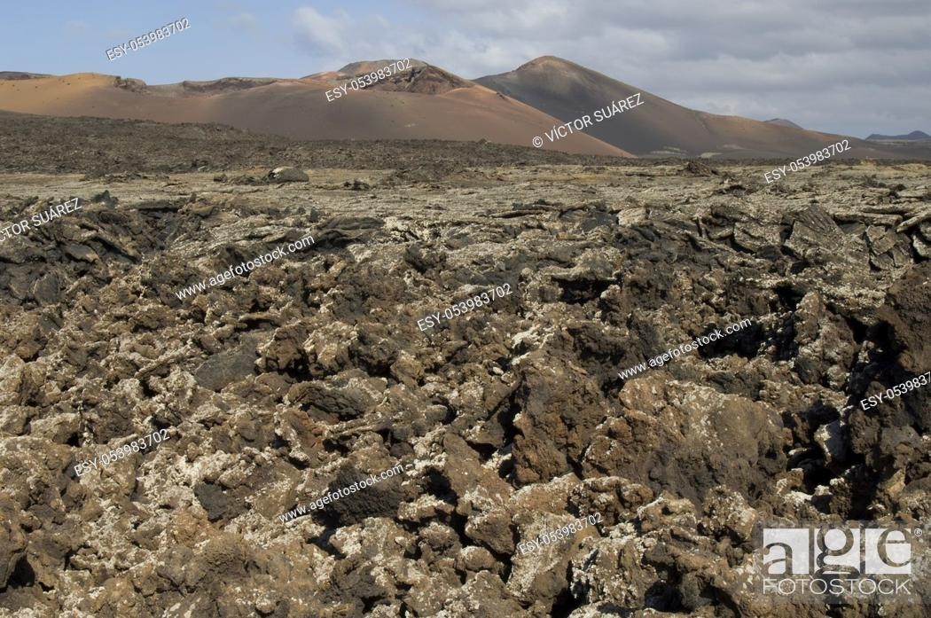 Stock Photo: Volcanic landscape. Los Volcanes Natural Park and Timanfaya National Park in the background. Lanzarote. Canary Islands. Spain.